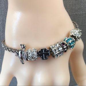 Cross and peace dove silver slider charm bracelet